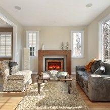 Ottawa living room featuring Amantii electric fireplace insert