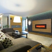 Large Ottawa home in Rockcliffe with a large electric fireplace featured in the wall.