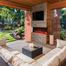 Outdoor living area complete with three-sided electric fireplace from Amantii brand