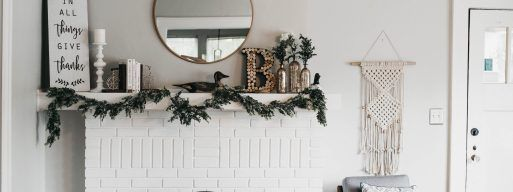 A beautifully decorated fireplace mantel in a home.