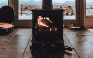 pellet stove in a modern, yet rustic home with snow in the backdrop