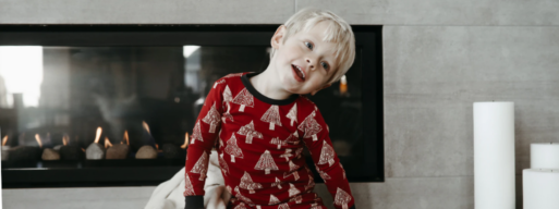 toddler sits in front of newly installed gas fireplace