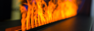 close up of a new gas fireplace that is on