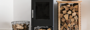 brand new indoor wood stove with stacks of wood stored neatly beside it
