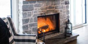 Grey brick wood burning fireplace